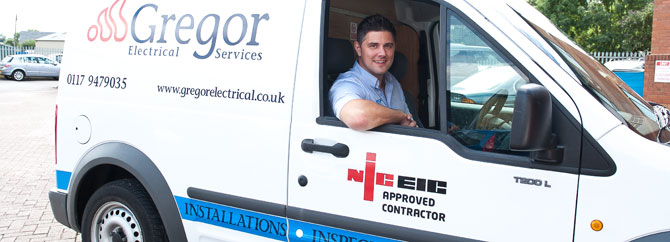 electrician in van with kit
