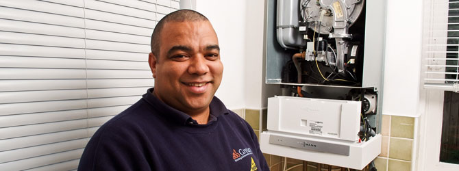 heating engineer with open boiler