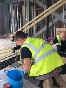 Father and son working in Poundbury